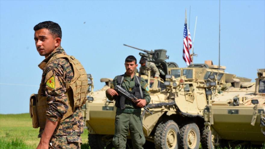 Fuerzas de las Unidades de Protección Popular (YPG, en kurdo) equipadas con vehículos blindados de EE.UU., abril de 2017.