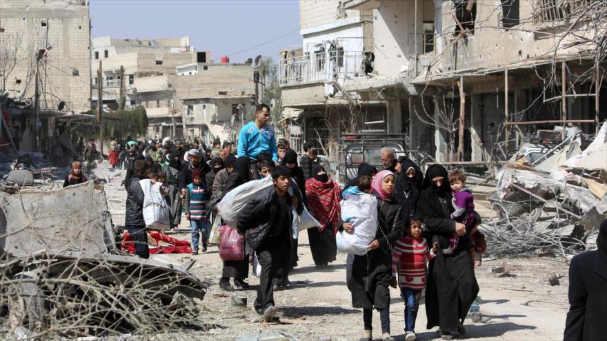 Evacuación de los civiles de la región de Guta Oriental, al este de la capital, Damasco, 17 de marzo de 2018.