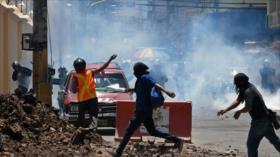 Reprimen las marchas por el Día del Trabajador en Honduras