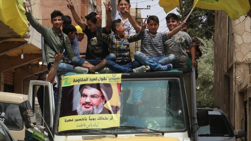 Los partidarios de Hezbolá con retratos de su líder, Seyed Hasan Nasrolá, en las calles de Baalbek durante las legislativas, 6 de mayo de 2018.