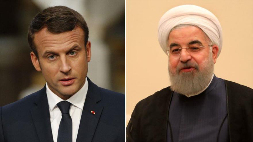 El presidente francés, Emmanuel Macron (izda.) y su homólogo iraní, Hasan Rohani.