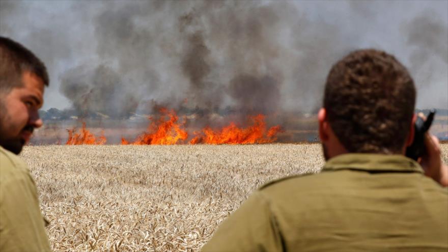 Soldados israelíes desplegados en la frontera entre los territorios ocupados palestinos y la Franja de Gaza, 14 de mayo de 2018.