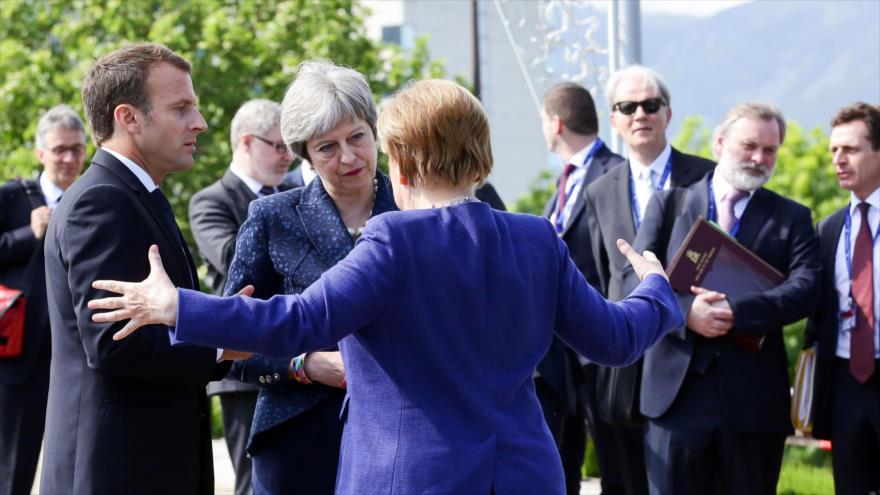 El presidente francés, Emmanuel Macron, la premier británica, Theresa May (C), y la canciller alemana, Angela Merkel, en Sofía, 17 de mayo de 2018.