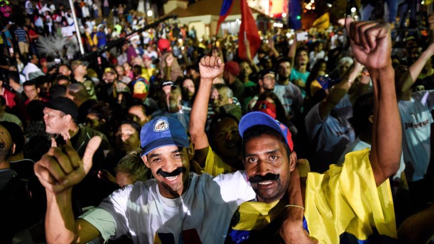 Los partidarios del presidente venezolano, Nicolás Maduro, celebran su victoria en las elecciones presidenciales, 20 de mayo de 2018.