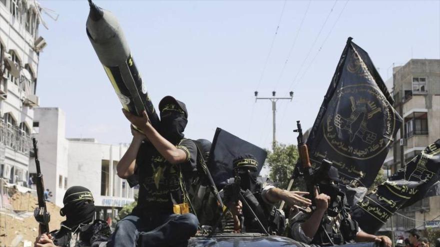 Integrantes de las Brigadas de Al-Quds, rama armada del Movimiento de Yihad Islámica Palestina durante un desfile en Gaza.