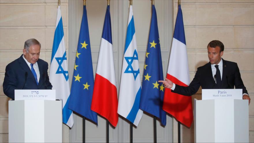 El presidente de Francia, Emmanuel Macron (dcha.), y el premier israelí, Benjamín Netanyahu, en una rueda de prensa en París, 5 de junio de 2018.