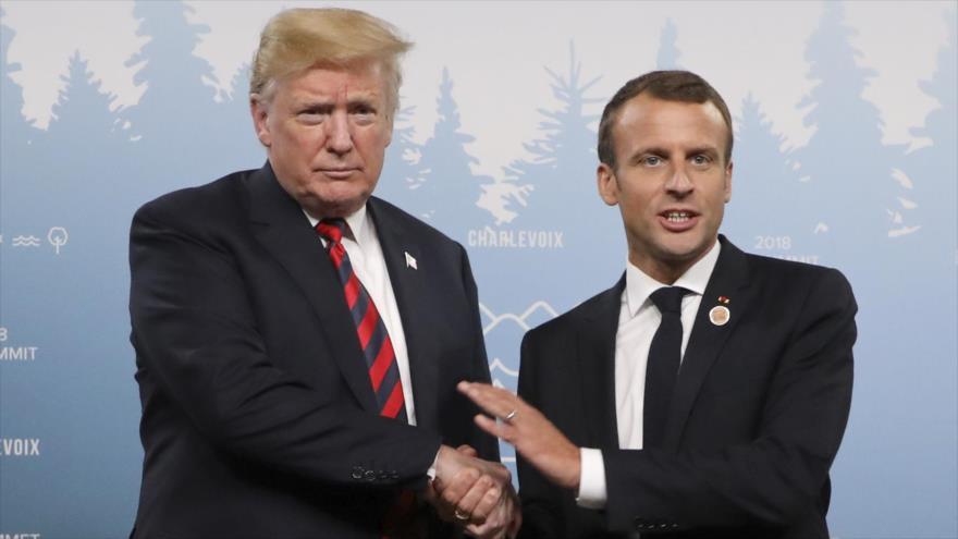 El presidente de EE.UU., Donald Trump (izq.), y el presidente francés, Emmanuel Macron, en la cumbre del G7 en Canadá, 8 de junio de 2018.