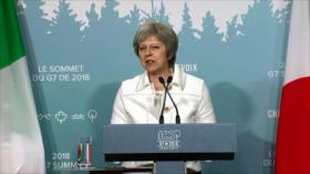 May sale de la cumbre del G7 con más preguntas que respuestas