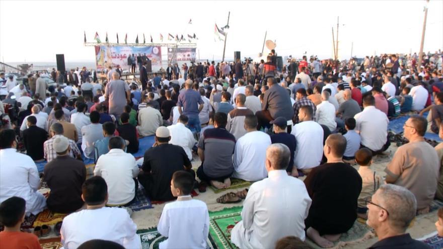 Gazatíes celebran la fiesta de Eid al-Fitr tras el fin de Ramadán