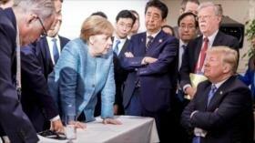 Trump lanzó agresivamente caramelos a Merkel en la Cumbre del G7
