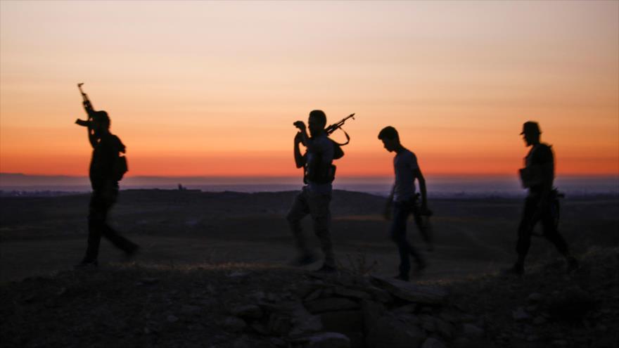 Integrantes de los grupos armados en Daraa, 3 de julio de 2018.