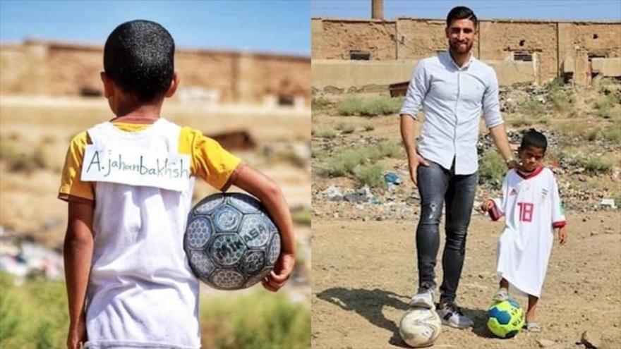El máximo goleador iraní de Liga de Holanda, Alireza Jahanbajsh, y su pequeño admirador, Matin.