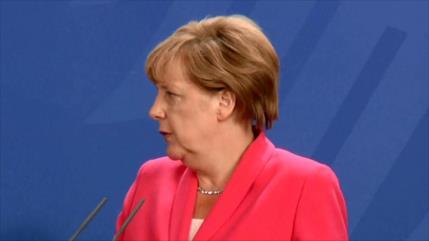 Trump blasfema sobre Merkel y ella se niega a contestar