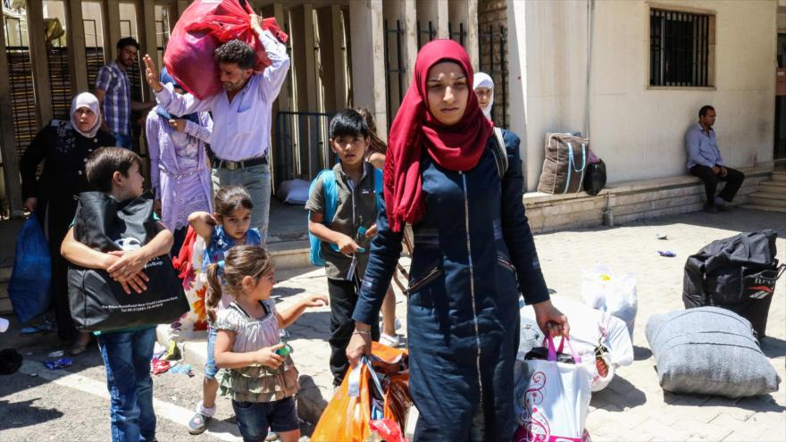 Refugiados sirios regresan a su país desde El Líbano, 28 de julio de 2018.