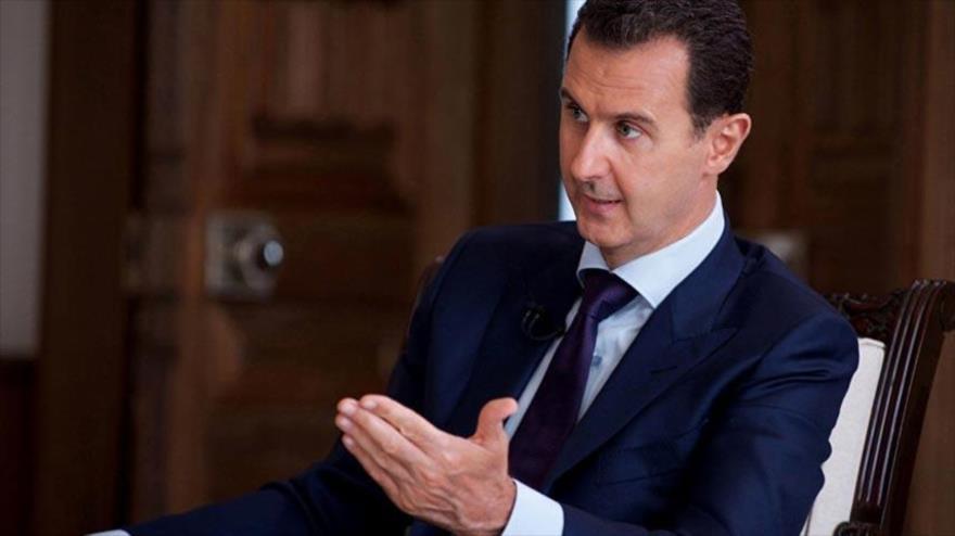 El presidente de Siria, Bashar Al-Asad, durante su entrevista con un medio local.