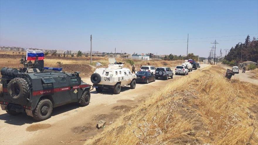 Vehículos blindados de la policía militar de Rusia y las fuerzas de las Naciones Unidas cerca de los altos del Golán, 2 de julio de 2018.
