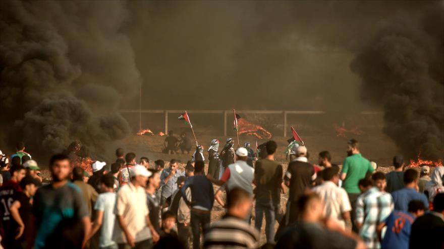 Palestinos protestam nas áreas fronteiriças entre a Faixa de Gaza e os territórios palestinos ocupados, em 3 de agosto de 2018.