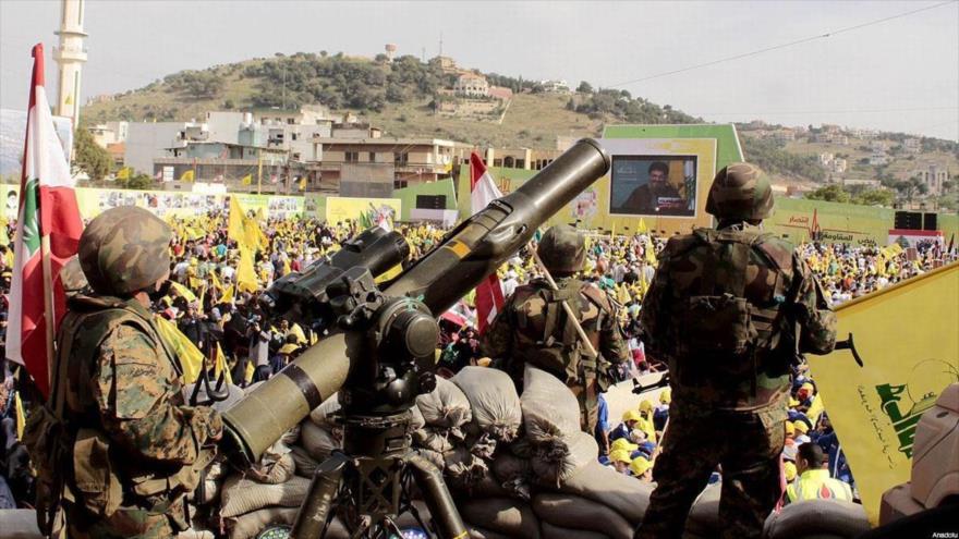 Combatientes de Hezbolá en una concentración de los partidarios del movimiento libanés.