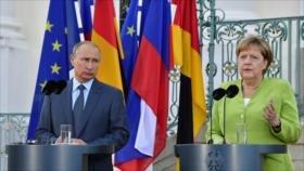 Merkel y Putin abogan por preservar el acuerdo nuclear con Irán