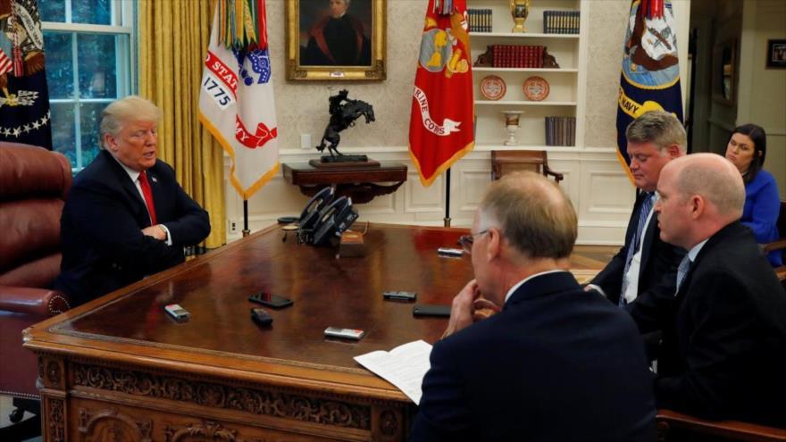 Trump dice que levantaría bloqueo a Rusia si coopera en Siria y Ucrania