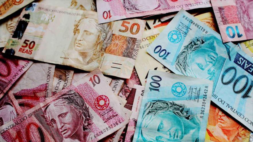 El real, la moneda brasileña.