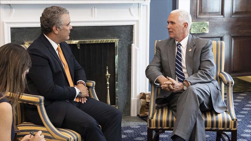 El presidente de Colombia, Iván Duque (izq.), y el vicepresidente de EE.UU., Mike Pence, 5 de julio de 2018.