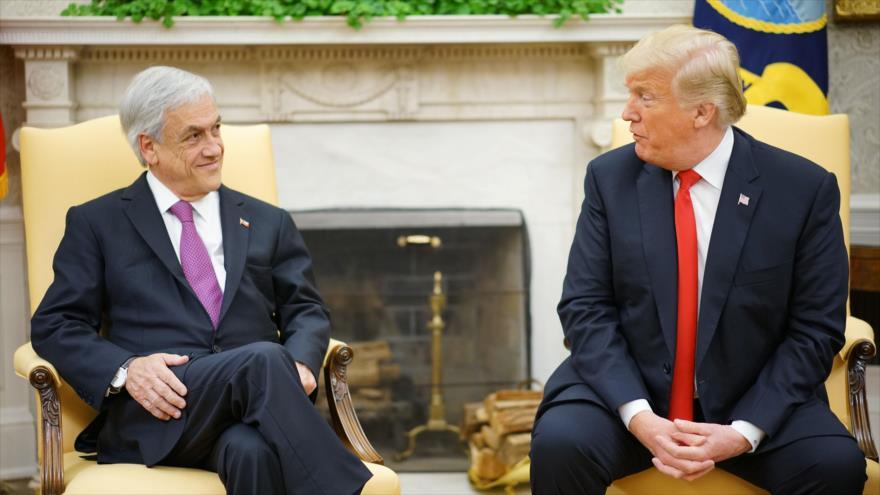 El presidente de los Estados Unidos, Donald Trump (drcha.) junto a su homólogo chileno, Sebastián Piñera, 28 de septiembre de 2018. (Fuente: AFP).