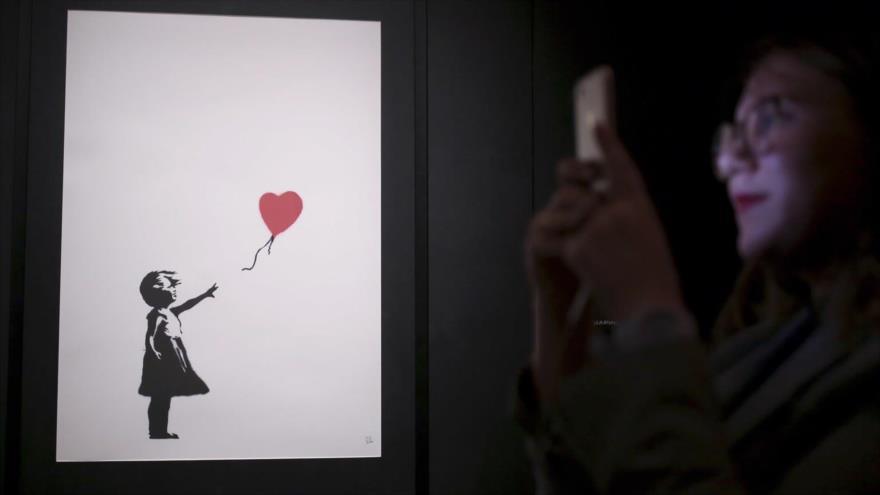 Obra artística se autodestruye nada más venderse por £1,4 millón | HISPANTV