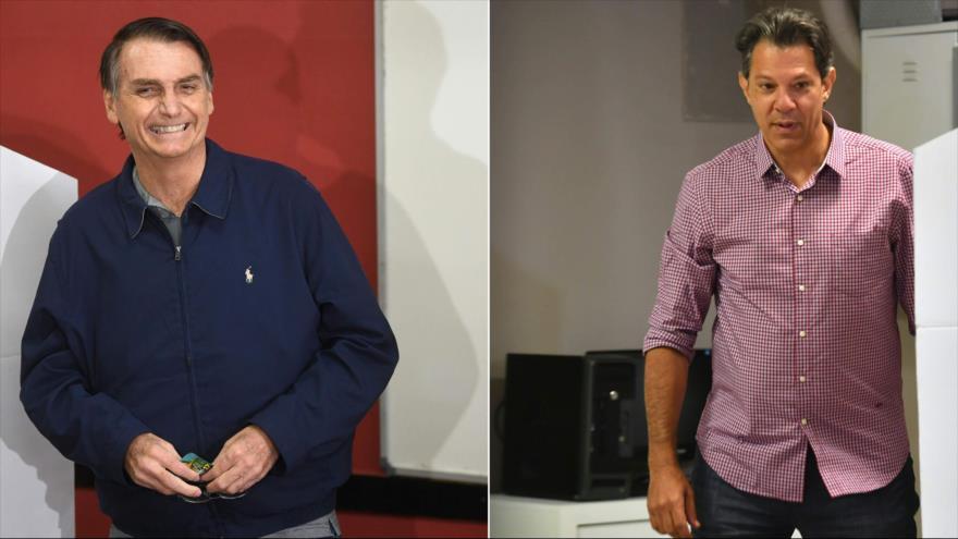 El candidato ultraderechista Jair Bolsonaro (izda.) y el izquierdista Fernando Haddad tras votar en presidenciales de Brasil, 7 de octubre de 2018. (Fuente: AFP)