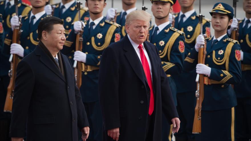 El presidente de EE.UU., Donald Trump, (dcha.) y su par de China, Xi Jinping, en Pekín, 9 de noviembre de 2017. (Foto: AFP)