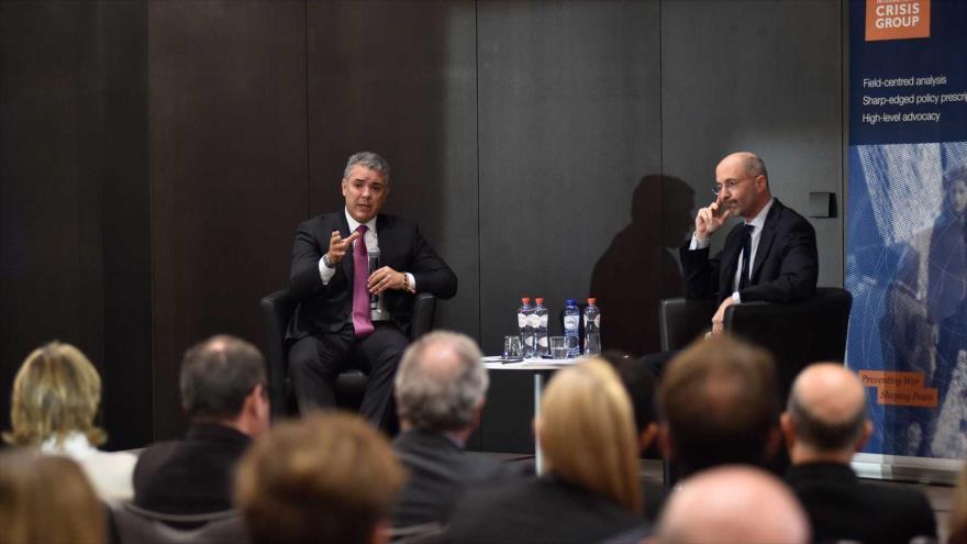 El mandatario de Colombia, Iván Duque (izq.), en un encuentro con el presidente del ICGI, Robert Maylle, Bruselas, 23 de octubre de 2018.