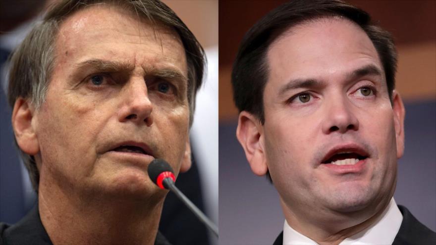 El candidato presidencial ultraderechista brasileño Jair Bolsonaro (izda.) y el senador estadounidense Marco Rubio.