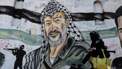 Palestinos conmemoran 14.º aniversario de la muerte de Arafat