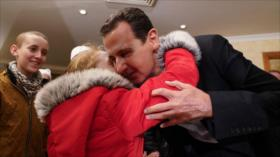 Al-Asad se reúne con mujeres y niños secuestrados por EIIL