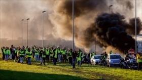Tras los insultos de Trump, Macron se enfrenta a masivas protestas
