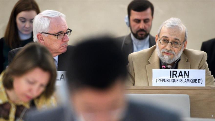 El secretario general del Comité de los Derechos Humanos del Poder Judicial de Irán, Mohamad Yavad Lariyani (dcha.), en Ginebra, 12 de marzo de 2018.