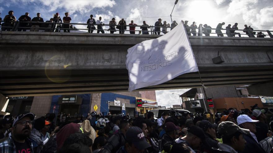 La caravana de migrantes protesta contra las amenazas de Trump