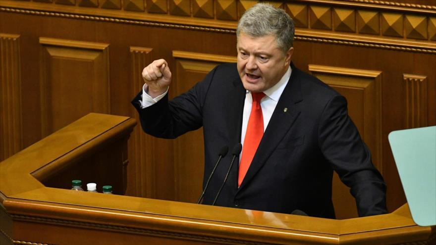 El presidente de Ucrania, Petro Poroshenko, habla durante una sesión de la Rada Suprema o Parlamento ucraniano, 26 de noviembre de 2018. (Foto: AFP)