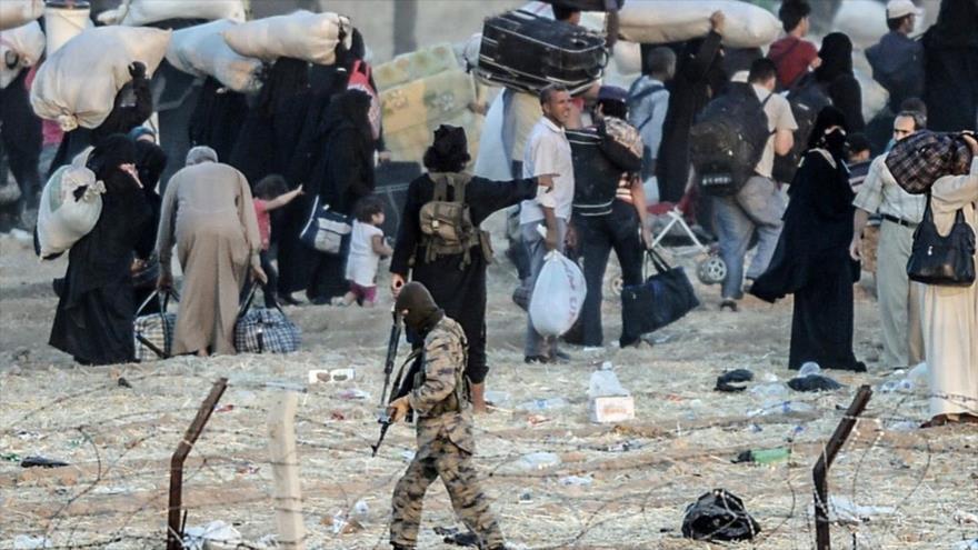 Los civiles atrapados en las regiones controladas por el grupo terrorista EIIL (Daesh, en árabe) en Siria.