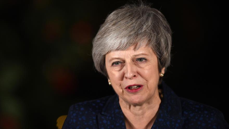 La primera ministra británica, Theresa May, realiza declaraciones tras ganar la moción de censura, Londres, 12 de diciembre de 2018. (Foto: AFP)