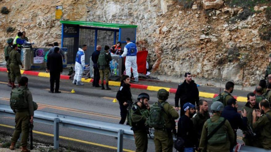 Soldados israelíes en el lugar de un tiroteo en la ciudad de Ramalá, en la Cisjordania ocupada, 13 de diciembre de 2018.