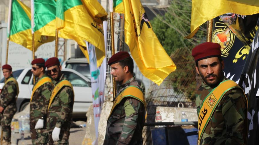 Los miembros de las Brigadas iraquíes de Hezbolá en una ceremonia en Bagdad (capital de Irak), 21 de junio de 2018. (Foto: AFP)