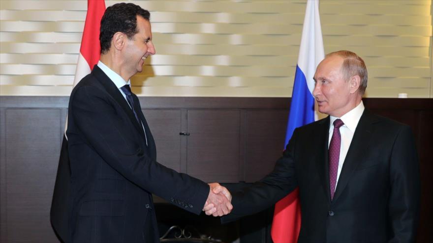 El presidente ruso, Vladimir Putin, reunido con su homólogo sirio, Bashar al-Asad, en Sochi (Rusia), 17 de mayo de 2018. (Foto: AFP)