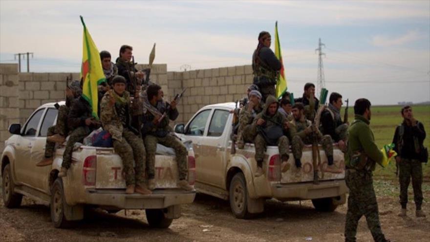 Vídeo: 400 milicianos kurdos salen de Manbij con rumbo al este | HISPANTV