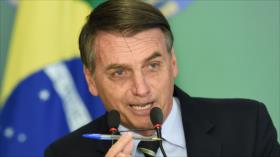 Bolsonaro firma polémico decreto que facilita el porte de armas
