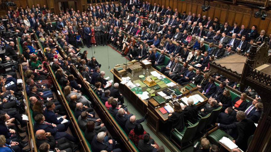 La premier británica, Theresa May, habla en la reunión del Parlamento para abordar el acuerdo del Brexit, London, 15 de enero de 2019. (Foto: AFP)
