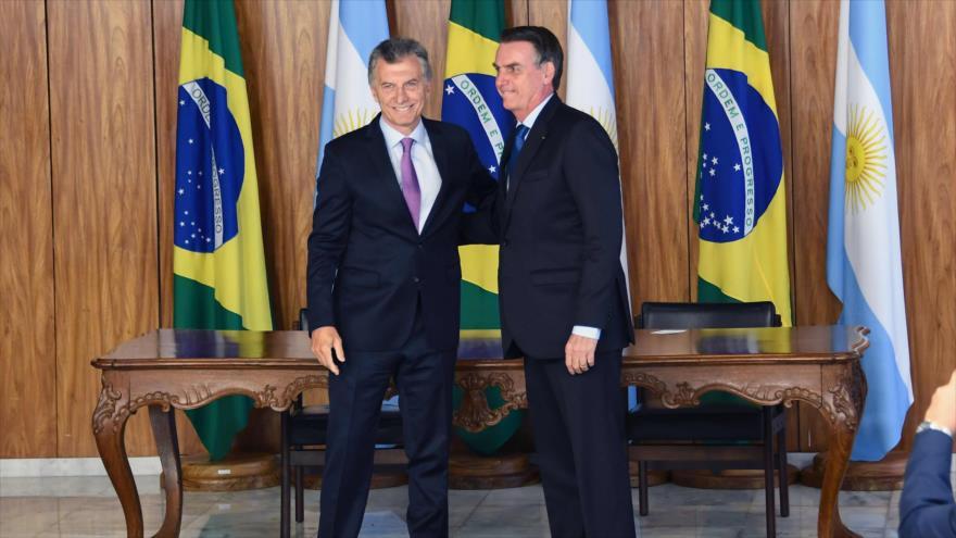 Los presidentes de Brasil y Argentina, Jair Bolsonaro y Mauricio Macri, en el palacio de Planalto, en Brasilia, 16 de enero de 2019. (Foto: AFP)