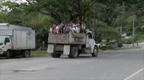 Caravana de migrantes hondureños cruza frontera con Guatemala