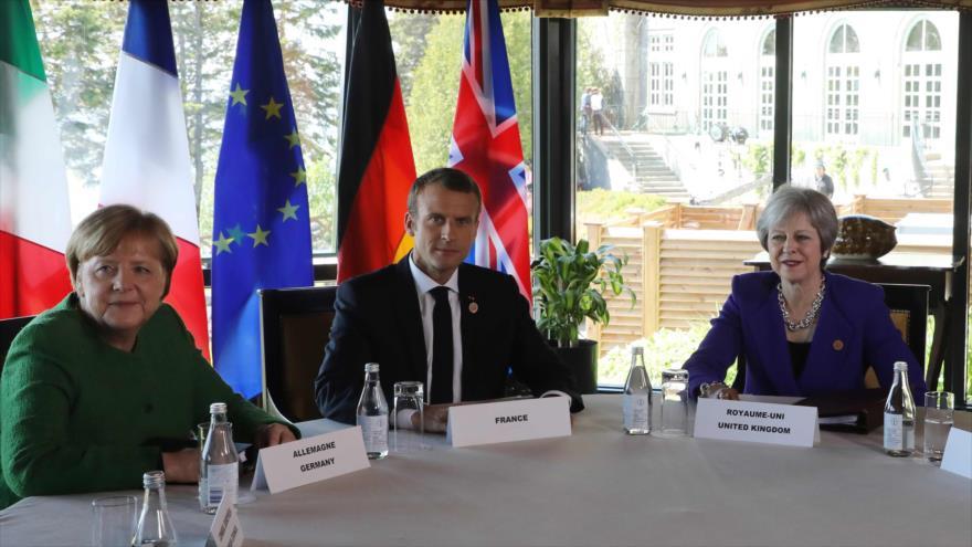 La canciller alemán, Angela Merkel, el presidente francés, Manuel Macron, y la premier británica, Theresa May, reunidos en Quebec, 8 de enero de 2018.