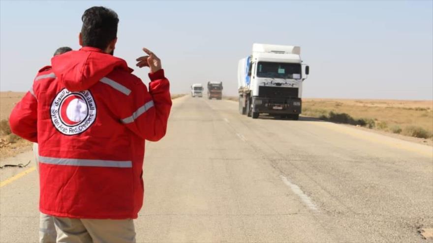Un convoy de la ONU y la Media Luna Roja Árabe Siria se dirige a un campamento de desplazados en Homs, Siria, 4 de noviembre de 2018. (Foto: AFP)